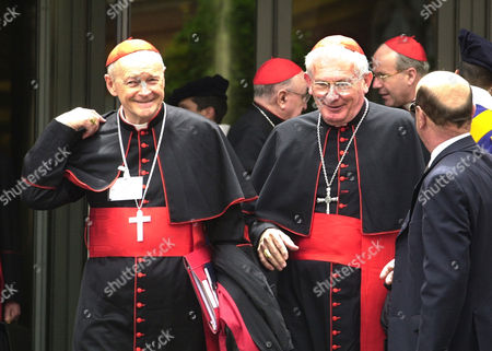 EGAN Cardinals William Henry Keeler, left, Archbishop of Baltimore, MD, and Theodore Edgar McCarrick, Archbishop of Washington DC, leave the major meeting with cardinals from around the world attended by Pope John Paul II in the Synod Hall at the Vatican, . The Pontiff called the meeting to examine the challenges of the church in the new millennium