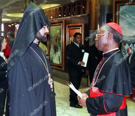ARINZE KHATCHERIAN Cardinal Francis Arinze, right, talks with Armenian Orthodox Reverend Kegham Khatcherian during a break for the interfaith council held in the Vatican . Against the backdrop of conflicts in Chechnya, Kosovo and East Timor, representatives from 20 of the world's religions accepted a Vatican invitation Monday to engage in interfaith dialogue on the world's problems, including conflicts sparked by religious differences