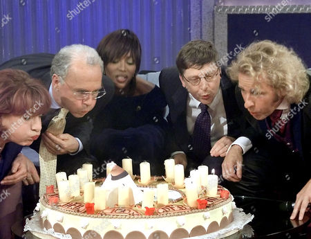 """GOTTSCHALK German actress Hannelore Hoger, former soccer player Franz Beckenbauer, top model Naomi Campbell, Bill Gates, chairman of Microsoft, and TV talkmaster Thomas Gottschalk, from left to right, blow out candles on a cake to celebrate the centenary jubilee of the German Soccer Association (DFB) during the TV show """"Wetten dass..."""" (Bet it...) in Leipzig, eastern Germany, Saturday night, . """"Wetten dass..."""" is one of the most successful TV shows in German television"""