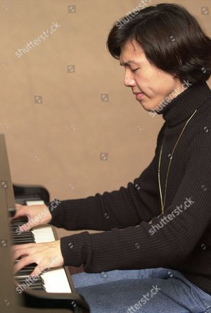 LI YUNDI Frederic Chopin International Piano Competition first prize winner Li Yundi of China plays a Chopin ballad, at Shenzhen Arts School, China. The 18-year-old Li was the first contestant to be awarded the gold medal in the prestigious competition since 1985