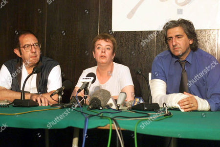 JOURNALISTS Renzo Cianfanelli, correspondent of the Italian daily Corriere Della Serra, left, Eve-Anne Prentice, correspondent of the London Times, center, and Daniel Schiffer, French philosophist, attend a press conference in Pristina . The three were wounded when NATO jets targeted an area near Prizren killing their Serb driver on Sunday