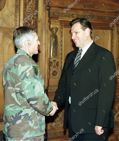 NATO Supreme Allied Commander Europe General Wesley K. Clark, left, shakes hands with Macedonian President Boris Trajkovski, in the Parliament building in Skopje, Macedonia, . General Clark is on a one day visit to Macedonia