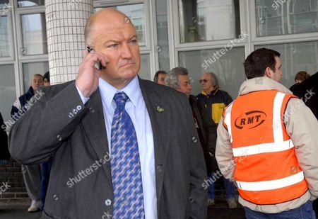 RMT Union general secretary Bob Crow on the phone