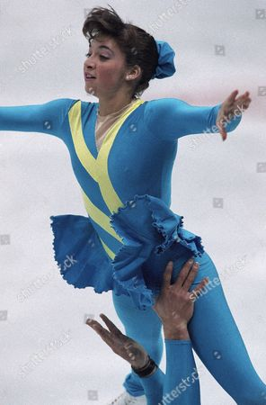Stock Photo of Isabelle Brasseur Canadian pairs figure skater Isabelle Brasseur is lifted skyward in the hands of her partner, Lloyd Eisler, in a practice session at the 1992 winter Olympics, Albertville, France