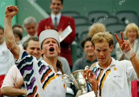 Luke Jensen, Murphy Jensen Luke Jensen, left, of the USA, raises his clenched fist in victory while his brother Murphy Jensen flashes the V-sign after they won the final of the men's doubles of the French Open tennis tournament in Paris, France, . The Jensens defeated Germany's Marc Goellner and David Prinosil 6-4, 7-6, 6-4