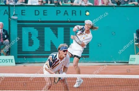 Murphy Jensen, Luke Jensen Murphy Jensen, left, waits at the net while his brother Luke volleys the ball during the final of the men's double match of the French Open tennis tournament in Paris, France, . The Jensens, of Ludington, Mich., defeated Germany's Marc Goellner and David Prinosil 6-4, 6-7 (7-4), 6-4