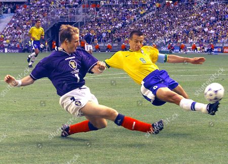 GALLACHER DUNGA Kevin Gallacher of Scotland, left, tackles Brazil's Dunga during the opening game of the 1998 Soccer World Cup at the Stade de France in St Denis . Brazil and Scotland play in Group A with Morocco and Norway