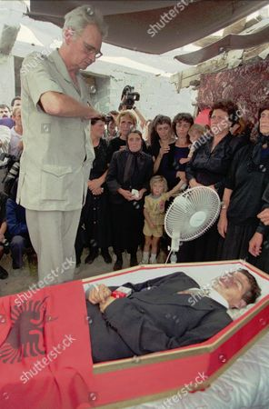 Stock Image of KING LEKA The pretender to the Albanian crown, King Leka I, stands to attention in front of the coffin of Agron Gjon Pali, who was killed in clashes between monarchist's supporters and police on Thursday, in Tirana . The royalists allege that the Socialist party stole their votes in a referendum on whether the country should remain a republic or become a monarchy