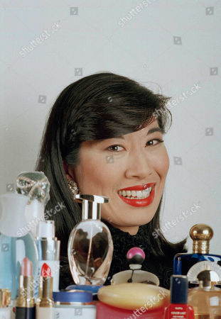 Avon executive Andrea Jung poses with Avon products at the company's headquarters in New York, . As head of global marketing, Jung is the driving force behind the recent makeover of the world's largest direct seller of beauty and fashion products