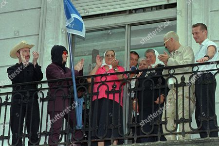 EDGE Mothers of The Plaza de Mayo and musicians of the Irish Band U2 greet the band's fans from the balcony of the Mothers' House Wednesday Feb.4,1998 in Buenos Aires. From left: The Edge, Bono, mothers Hebe de Bonafini, and Ana Barimbaum, Adam Clayton and Larry Muller. The Irish group will give three concerts in Argentina