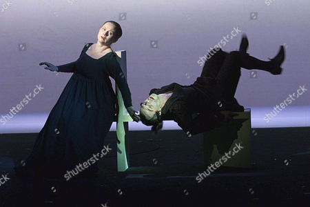 """WUTTKE KOGGE Martin Wuttke as Danton, right, and Imogen Kogge as his wife Julie,left, in a scene of Georg Buechner's drama """"Dantons Tod"""" seen, during a rehearsal of the Salzburg Festival. The premiere of the Robert Wilson production is on Saturday July 25,1998 in Salzburg"""