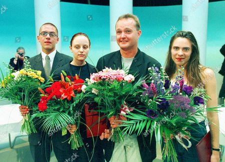 Stock Image of PREISVERLEIHUNG Steffen Kopetzky, Bettina Galvagni, Norbert Niemann and Zoe Jenny, from left, awarded Austrian literature prize (Ingeborg Bachmann prize), pose with flowers at the ORF theatre in Klagenfurt