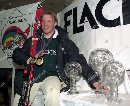 MAIER Double Olympic champion and first Austrian to win the overall World Cup title since Karl Schranz in 1970 Hermann Maier poses with his trophies, during an official welcome ceremony in his hometown Flachau in the province of Salzburg. In addition to the overal World Cup Maier also captured the titles in super-G and giant slalom