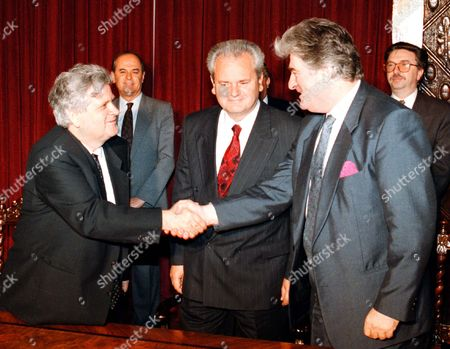 ABDIC MILOSEVIC KARADZIC Former muslim warlord in the Bosnian war, Fikret Abdic, left, shaking hands with wartime Bosnian Serb leader Radovan Karadzic, right, during a signing ceremony in Belgrade in October 1993. Abdic and Karadzic signed a cooperation agreement under the auspicies of then Serbian president Slobodan Milosevic, center. The Bosnian government confirmed Tuesday, Jan. 5. 1998, that they are seeking Abdic's extradition from Croatia to prosecute him for war crimes