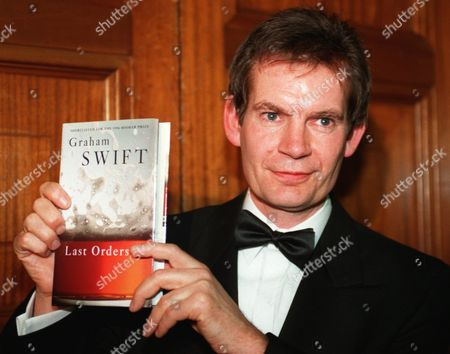 GRAHAM SWIFT Author Graham Swift of London holds up his novel Last Orders after it was announced Swift had won the Booker Prize for Fiction at a ceremony at the Guildhall in London