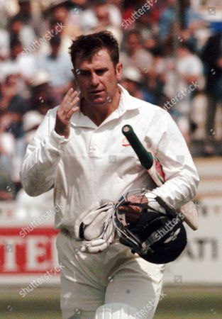 MARK TAYLOR Australia's captain Mark Taylor walks away in despair after being caught in the slips by England's Mark Butcher off the bowling of Devon Malcolm for seven runs on the the first day of the 1st test match at Edgbaston in Birmingham
