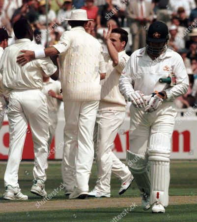 MARK TAYLOR Australia's captain Mark Taylor walks away after losing his wicket caught in the slips by Mark Butcher off the bowling of Devon Malcolm for seven runs on the first day of the 1st Test at Edgbaston in Birmingham