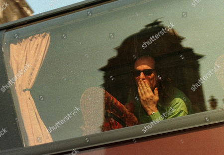 Stock Picture of German Eurovision entry Guildo Horn, with St Phillips Cathedral reflected in the glass, blows a kiss from his coach as he leaves his hotel to go to the final rehersal ahead of the evening's competition, . Horn, a cult figure in Germany, is second favourite to win the contest which will be watched by over 100 million people worldwide