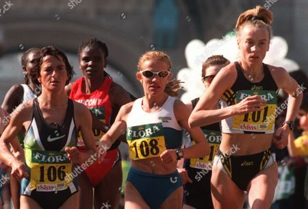 Britain's liz McColgan at right, leads the second group over Tower Bridge during the London Marathon, . the Womens race was won by Kenya's Joyce Chepchumba third left, between 106 and 108