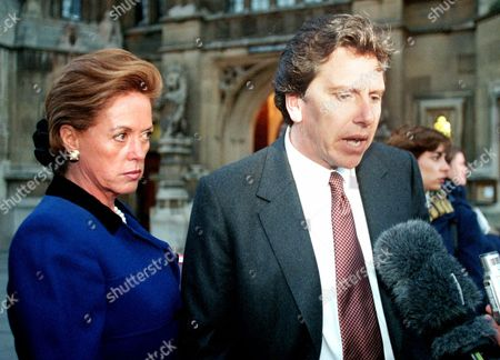 Supporters of former Chilean President Gen. Augusto Pinochet Maria Angelica Cristi, left, and Alberto Espina speak outside the House of Lords in London, . Lawyers for Pinochet told Britain's highest court Monday that to uphold the former dictator's arrest would imperil Chile's fragile democracy