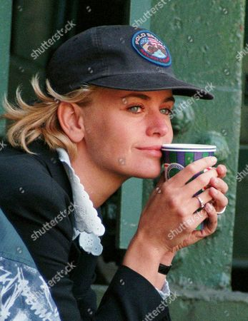 Dutch model Daphne Deckers holds a drink, while watching boyfriend Richard Krajicek during his Men's Singles semi-final against Jason Stoltenberg, on Wimbledon's Number One Court . Krajicek won the match 7-5, 6-2, 6-1 and will meet Malivai Washington in the final of the tournament