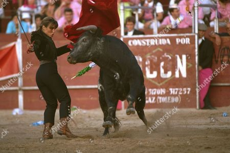 Female bullfighter Cristina Sanchez, 20, executes a chest pass during a bullfight in Segovia, Spain, 80 kilometers (49 miles) north of Madrid, . Sanchez was awarded two ears for her performance