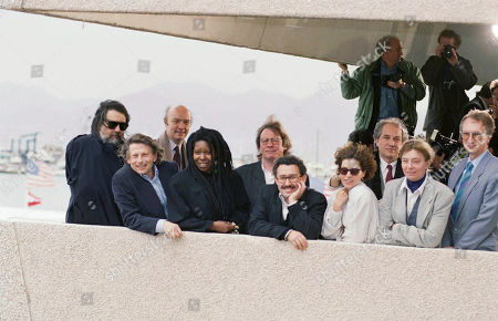 Watchf Associated Press International News Entertainment FRANCE APHS58313 CANNES FILM FESTIVAL Members of the 44th Cannes International Film Festival jury pose before the opening of the festival, in Cannes. From left: Greek composer Vangelis, Polish-born movie director (jury's president) Roman Polanki, French movie director Jean Paul Rappeneav, American actress Whoopie Goldberg, British director Alan Parker, Tunisian journalist Ferid Boughedir and Soviet actress Natalie Negoda