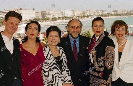 "Watchf Associated Press International News Entertainment FRANCE APHS58310 CANNES FILM FESTIVAL Mexican film director, Arturo Ripstein, center, poses with his actors, from left American film director Alex Cox, actor in this movie, Blanca Guerra, Anna Ofelia Murguia, Patricia Reyes Spindola, and Paz Alicia Garcia Diego, Ripstein's wife and actress, for the film ""La Reina De La Noche"" (The Queen of the Night) in competition for Mexico, at the 47th International Film Festival"