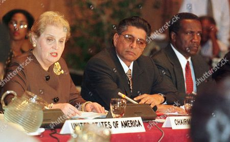 Stock Photo of CARIBBEAN ALBRIGHT U. S. Secretary of State Madeleine Albright, left, Trinidad and Tobago Minister of Foreign Affairs Ralph Maraj, and CARICOM Sercetary General Edward Carrington, right, at the opening session of the Caribbean Ministerial Meeting in Port of Spain, Trinidad, Monday morning, . Albright vowed Monday to fight for trade benefits for Caribbean nations that already have been rejected by Congress