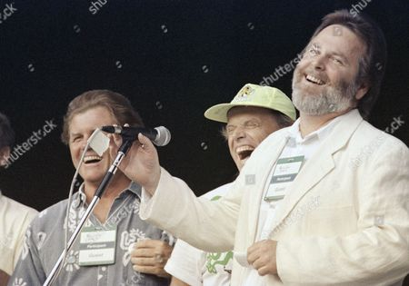 Carl Wilson, Mike Love, Bruce Johnston Members of the singing group, ?The Beach Boys,? Carl Wilson, at microphone, Mike Love, center, and Bruce Johnston announce on in Rio that they have teamed up with ?Earthkind.? ?Earthkind? is non-governmental organization promoting care for the environment. They also are involved with ?Eyewitness for the Earth,? an organization providing video cameras to non-governmental organizations with a story to tell