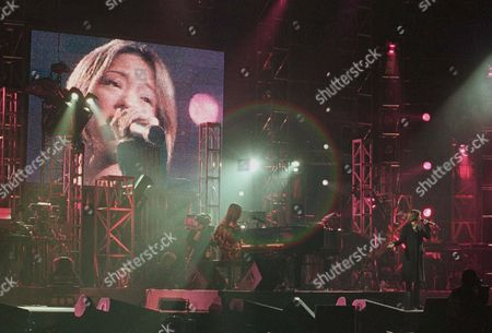 Stock Photo of NAMIE AMURO Japanese pop star Namie Amuro, right, performs on stage with Tetsuya Komuro, center, at Beijing's Capital Stadium . The concert was Amuro's first major performance since the announcement of her marriage and pregnancy