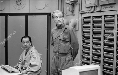 David Yip (left) with Julian Sands  in 'Murder On The Moon' - 1989