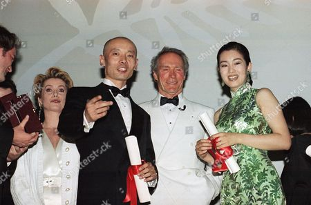"""Clint Eastwood, Ge You, Gong Li U.S. actor Clint Eastwood, President of the jury (center) poses with the two main Chinese actors of Zhang Yimou's film """"To Live,"""" which received the Jury Grand Prix at the 47th Film Festival in Cannes, French Riviera, . Ge You, left, received the Best Actor Award, while Gong Li poses with her director's award as Zhang Yimou did not attend the festival to protest Chinese censors' rejection of the film"""