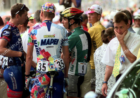 Race official and former French cyclist Charly Mottet, right, looks dejected as riders, from left Frankie Andreu of the USA, Wilfried Peeters of Belgium, Erik Zabel of Germany and Jan Ullrich of Germany, discuss during a protest at the start of the 12th stage of the Tour de France cycling race between Tarascon-en-Ariege and Le Cap d'Agde, southern France