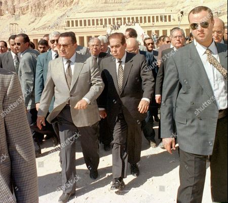 Egyptian President Hosni Mubarak, center left, is accompanied by Egyptian Prime Minister Kamal Ganzouri, center, as they tour the site of Monday's massacre at the valley of the kings in Luxor. Following the shooting in which 58 tourists were killed by Muslim extremists, several tour groups have announced that they are pulling back their tourists from Luxor