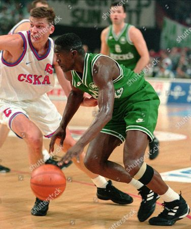 WILKINS PANOV Panathinaikos player Jacques Dominique Wilkins, right, dribbles past Moscow's Serguei Panov during their semifinal of the European Club Champions at Paris Bercy stadium on . Panathinaikos won the game 81-71
