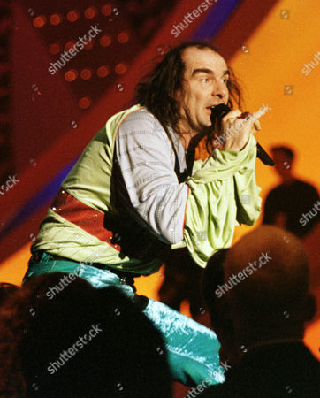 Germany's Guildo Horn performs on stage in the final dress rehearsal ahead of the final. Horn, a cult figure in Germany, made waves in 1998 with his velvet trousers, platform shoes and ruffled shirt. He rushed across the stage, playing cowbells and climbing up on the scaffolding, too. Similar eccentricities are expected at this year's event in the Swedish capital of Stockholm, the final of which takes place on Saturday, May 14
