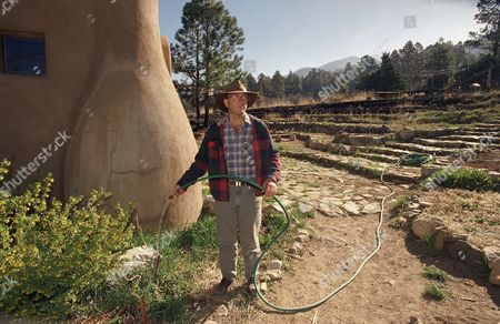 Ben Haggard Though the Carson National Forest wildfires that swept through the Lama Foundation destroyed many of the group's structures and plantlife, some areas, including the main meeting hall and a portion of the vegetable garden, survived. Ben Haggard on is watering the surviving vegetable garden, in hopes of preserving those things that survived while the group plans to replace things destroyed by the wildfires that swept through the village of La Lama in northern New Mexico last Sunday