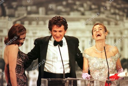 "BEART BONNAIRE PENN US actor Senn Penn, center, shares a laugh with French actresses Emanuelle Beart, left, and Sandrine Bonnaire after Penn was awarded the best actor for his role in Nick Cassavetes' ""She's so lovely"" at the Cannes film festival"