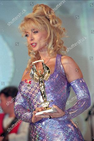 """NINA HARTLEY American porn movie actress Nina Hartley holds her trophy after being awarded with an honorary """"Hot d'Or"""" (Golden Hot) for her career, in Cannes, French Riviera. The 5th Hot d'or ceremony gathers actors actresses and producers of the world porn film industry"""