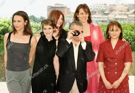 The female members of the jury of the 51st International Cannes Film Festival pose with Jury President, US film director Martin Scorsese with camera, center, at the Festival Palace in Cannes, French Riviera . From left: Swedish actress Lena Olin, U.S. actress Winona Ryder, Italian actress Chiara Mastroiani, Martin Scorsese, US actress Sigourney Weaver, Cuban writer Zoe Valdes