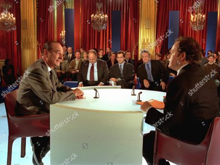 FIELD French President Jacques Chirac, left, faces newsman Guillaume Durand shortly before the start of his TV interview at the Elysee presidential palace in Paris . Journalists seated in background waiting to interview President Chirac are from left Alexandre Adler, Emmanuel Chain and Michel Field