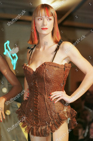 A model sports a chocolate corset designed by Chantal Thomas at the 4th Chocolate Fair in Paris