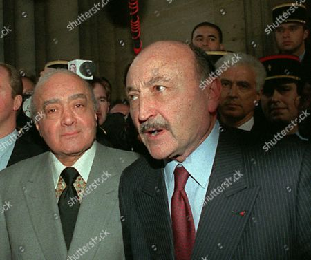 AL FAYED KIEJMAN Mohamed Al Fayed, left, the father of Dodi Al Fayed, the companion of Britain's Princess Diana, and his lawyer Georges Kiejman as they face reporters after they met for two hours with the French judge investigating the car crash that killed the couple and their driver, at the Paris courthouse