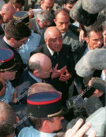 FAYED Mohamed Al Fayed, center top gesturing, speaks to reporters after hearings in Paris in the case trying to determine whether photographers were to blame for the Aug. 31, 1997 car crash and death of his son Dodi, Princess Diana and their driver. The all-day meeting was not expected to yield any immediate results. But it was a way for Judge Herve Stephan, who heads the massive investigation, to balance conflicting accounts in the case file. Al Fayed's lawyer Georges Kiejman is at center left in front of Al Fayed