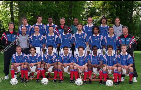 The French national soccer team for the EURO 96 soccer tournament poses at the Clairefontaine training center, outside Paris, . First rowfrom left; Vincent Guerin, Reynald Pedros, Patrice Loko, Sabri Lamouchi Joslin Angloma, Bixente Lizarazu, Didier Deschamps. Second row from left; Franck Leboeuf, Eric Di Meco, Alain Roche, Lilian Thuram, Christophe Dugarry, Christian Karembeu, Youri Djorkaeff. Third row: Zinedine Zidane, Laurent Blanc, Marcel Desailly, coach Aime Jacquet, goalkeeper Bernard Lama, Fabien Barthez, Mikael Madar. Three coaches beside are unidentified
