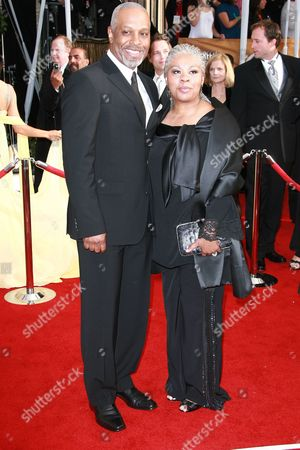 Stock Picture of James Pickens Jr. and Gina Pickens