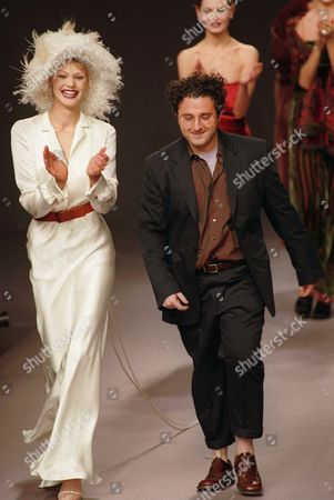ELBAZ American fashion designer Albert Elbaz, applauded by models, walks on the stage after the presentation of Guy Laroche's 1997-98 fall-winter ready-to-wear collection