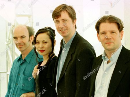 """HARTLEY U.S. director Hal Hartley, center, poses for the press with Japanese actress Mino Nikaido, Australian actor Nicholas Hope, left, and Canadian born actor Thomas Jay Ryan, right, during the photo call of the Hartley's movie """"Henry Fool"""", at the International Film Festival, in Cannes, French riviera . Hartley's movie """"Henry Fool"""" will be screened Tuesday night to the members of the jury of the 51st International Film Festival"""