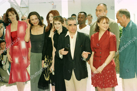 The members of the Jury of the 51st International Cannes Film Festival pose for the press at the Festival Palace in Cannes, French Riviera, on . From left: US actress Sigourney Weaver, Sweden's Lena Olin, Italian actress Chiara Mastroiani, U.S.actress Wynona Ryder, US film director Martin Scorsese who presides the jury, French singer Mc Solaar, Chinese director Chen Kaige, Cuban writer Zoe Valdes and French director Alain Corneau